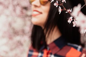 Girl next to an almond blossom