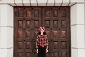 Woman next to a wooden door