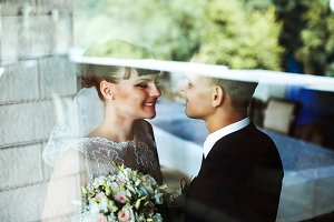 Bride and groom behind the glass