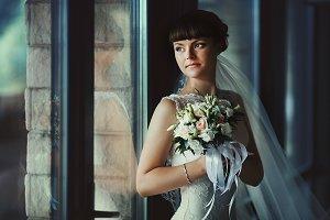 Beautiful bride behind a window