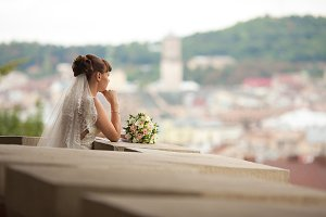 Bride leaning on the balcony