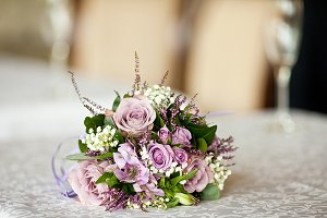 Delicate bouquet of violet roses