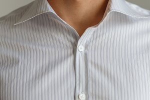 White shirt on the businessman. Unbuttoned collar.