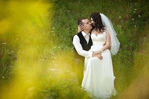 Beautiful bride strokes groom's head