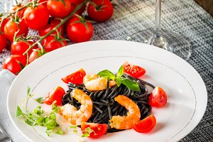 Black spaghetti with prawns and cherry tomatoes