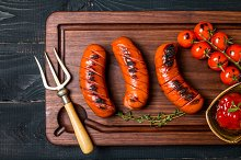 Grilled sausage with tomato and ketchup