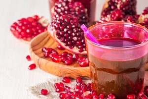 juice and ripe red pomegranate