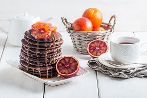 Chocolate pancakes with orange and caramel sauce