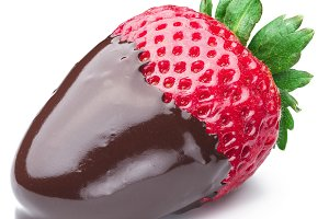 Strawberry dipped in chocolate fondue on white background.