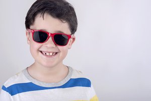 Smiling boy with sunglasses