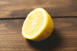 Half lemon on wooden table. Horizontal shoot.