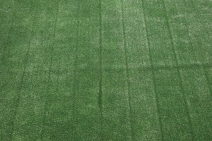 green synthetic grass texture background