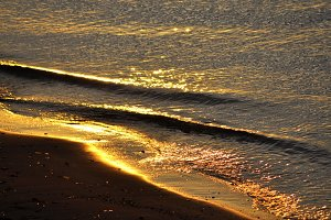 Small golden waves on sand