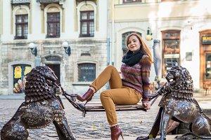 beautiful girl sitting on bench