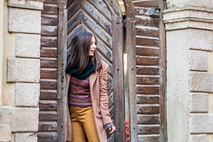 girl near old wooden gate