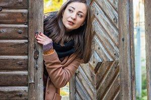 girl near old wooden gate