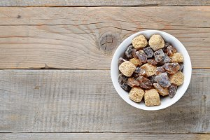 Brown sugar in bowl on table
