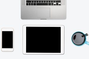 Simple clean white desktop with electronic equipment