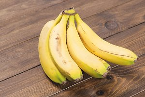 Bananas on wooden table. Food. Horizontal shoot.