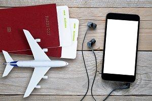 Plane tickets, passports, smartphone
