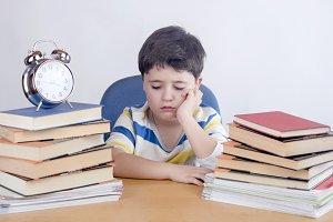 Boring schoolboy studying