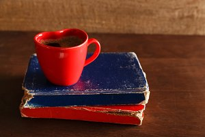 Old book and coffee cup