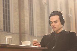 headphones man smartphone relaxing
