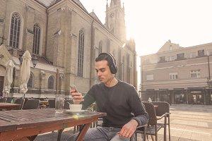 sunny day man smartphone headphones