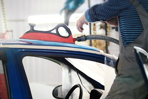 Automobile service - manual labor - polishes car, close up