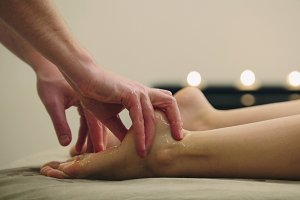 Massage for foot. Relaxation treatment for young female, close up