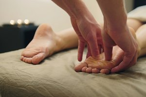 Sesame oil massage for footstep. Relaxation treatment for young female, close up