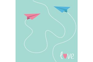 Pink and blue origami paper planes.