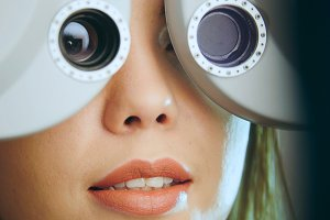 Ophthalmology - young woman checks the eyes on the modern equipment in the medical center