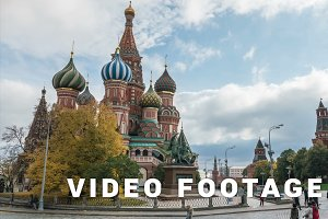 Tourists do selfies at the background of Saint Basil Cathedral on Red Square