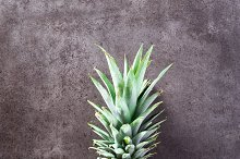 ripe pineapple on grey