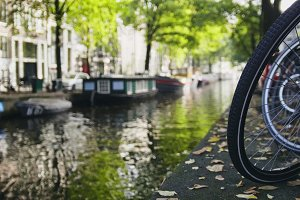 View of wheel  bicycle on the Amsterdam canal, sunny day