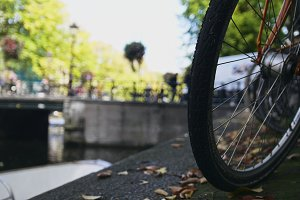 View of wheel  bicycle on the Amsterdam canal, sunny european autumn