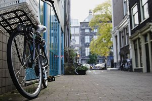 View bicycle standing in the yard on Amsterdam, sunny european autumn