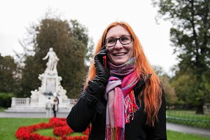Young red hair woman using cell phone in Vienna