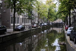 View of Amsterdam city canal, early morning, cloudy day, Autumn, Netherlands