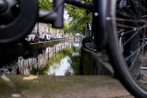 Amsterdam street with bicycles and cars on canal, Autumn, Netherlands