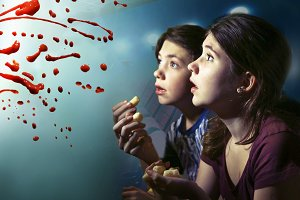 teens boy and girl watching horror movie film