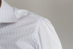 Leche and collar of a representative white shirt