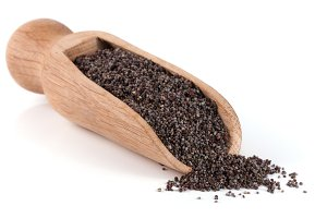 poppy seeds in a wooden scoop isolated on white background