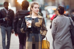 businesswoman walking on city