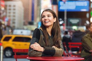 woman smiling looking up outdoors