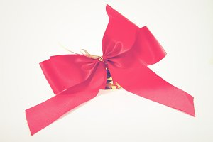Red ribbon and golden bell