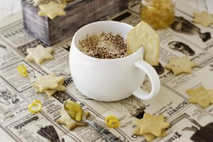cup of aromatic cappuccino with cookies, orange marmalade. selective focus