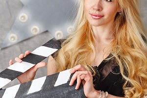 Girl with an empty clapperboard