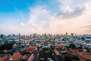 Aerial view on the roofs of Bangkok from the Golden Mountain, Thailand. Cityscape panorama photography of old city center buildings architecture at sunset time, outdoor landscape